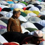 Muslims pray during Eid al-Fitr prayer, which marks the end of the holy month of Ramadan, in Palermo, Italy. Muslims around the world celebrate the Eid al-Fitr, the feast that marks the end of the holy fasting month of Ramadan. (AP Photo/Alessandro Fucarini)