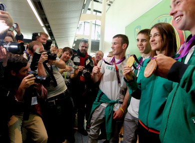 Michael Conlan, second from left, poses with his fellow Olympic medallists John Joe Nevin, Katie Taylor and Cian O'Connor in Dublin Airport.