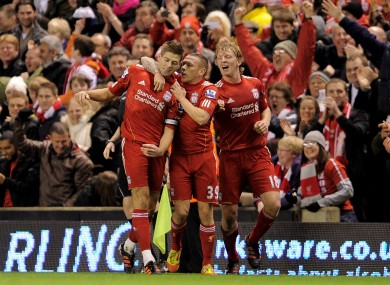 Bellamy with former skipper Steven Gerrard and the departed Dirk Kuyt.