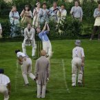 A game of cricket is played by performers during the London Olympic Games 2012 Opening Ceremony at the Olympic Stadium, London.