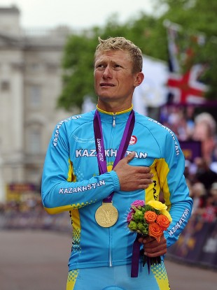 Kazakhstan's Alexander Vinokourov celebrates winning Gold in the Men's Road Race last month.