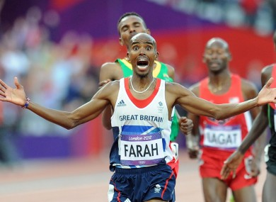 An ecstatic Farah crosses the line.