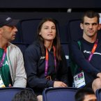 Ireland's gold medallist Katie Taylor watches on with her dad Peter, left, and teammate Adam Nolan.