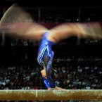 Italy's Vanessa Ferrari competes on the beam during the Artistic Gymnastics team qualification at the North Greenwich Arena, London
