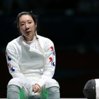 Shin A-Lam of South Korea refuses to leave the stadium after she is controversially beaten when the clock was reset from zero to one second. (Julien Behal/PA Wire)
