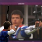 France's Gael Prevost shoots during the men's individual archery competition at the 2012 Summer Olympics, Friday, Aug. 3, 2012, in London. (AP Photo/Marcio Jose Sanchez)