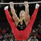 German gymnast Fabian Hambuchen performs on the horizontal bar during the artistic gymnastics men's apparatus finals at the 2012 Summer Olympics, Tuesday, Aug. 7, 2012, in London. (AP Photo/Gregory Bull)