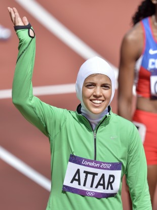 Saudi Arabia's Sarah Attar waves before competing in a women's 800-metre heat.