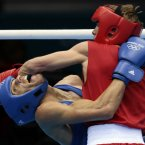 Russia's Sergey Vodopiyanov, right, fights Brazil's Robenilson Vieira de Jesus, during their men's bantam 56-kg boxing match at the 2012 Summer Olympics, Wednesday, Aug. 1, 2012, in London. (AP Photo/Ivan Sekretarev)