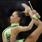 Russia's Daria Dmitrieva during the rhythmic gymnastics individual all-around qualifications  at the 2012 Summer Olympics, Friday, Aug. 10, 2012, in London. (AP Photo/Gregory Bull)