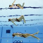 Japan compete during women's duet synchronized swimming preliminary round at the Aquatics Centre in the Olympic Park during the 2012 Summer Olympics in London. (AP Photo/Mark J. Terrill)
