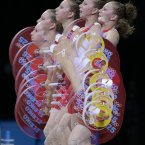 In this multiple exposure photo, Annie Moniqui of Canada competes during the women's 58-kg, group B, weightlifting competition at the 2012 Summer Olympics, Monday, July 30, 2012, in London. (AP Photo/Hassan Ammar)