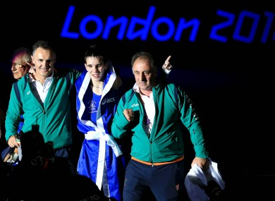 Coaches Billy Walsh, left, and Zaur Antia, right, with Michael Conlan after he secured Olympic bronze with a win against Nordine Oubaali.