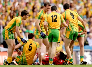 Corks' Paul Kerrigan concedes a free surrounded by Donegal players.
