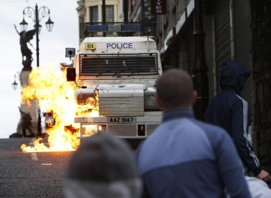 File image of a petrol bomb being thrown at a police van in Derry in August 2008