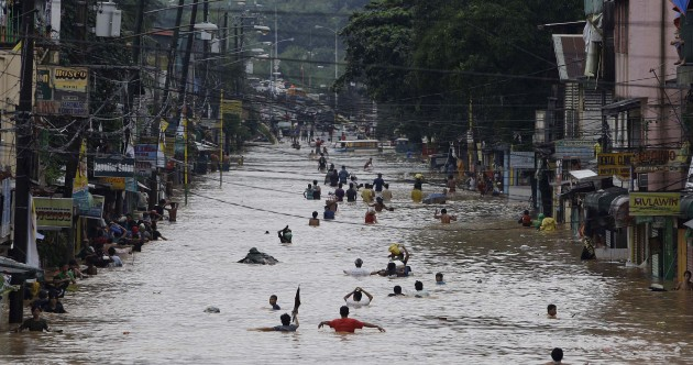 In photos: Torrential rains deluge Manila