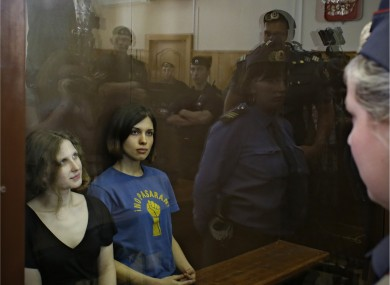 Two members of Pussy Riot, Maria Alekhina and Nadezhda Tolokonnikova, in the glass cage in the Moscow courtroom on Friday