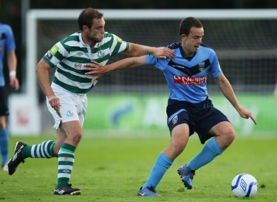 UCD's Robbie Benson and Stephen Rice of Shamrock Rovers.