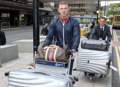 Rooney arriving at Manchester airport this week.