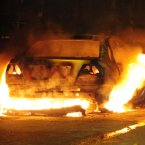 A car burns in Toxteth on Merseyside after disturbances spread to Liverpool from London.