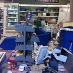The inside of a Tesco Metro on East Dulwich Road in south London, which was attacked by looters during the third night of rioting in London.