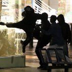 The riots spread to other cities too..here, looters try to kick in the window of a jewellers shop near the Bullring shopping centre in Birmingham on Monday 8 August 2011. Image: David Jones/PA