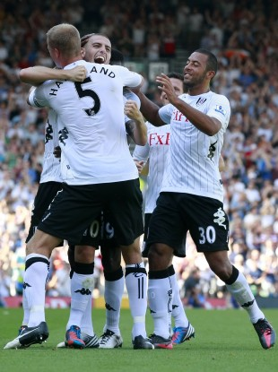 Mladen Petric (second left) celebrates scoring Fulham's second goal.