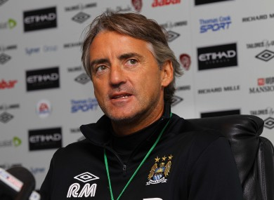 Manchester City manager Roberto Mancini could be headed for conflict with his Argentinian counterpart over Sergio Aguero.