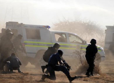 South African police opening fire during the strike confrontation on 16 August.
