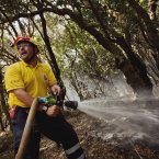 A firefighter works to halt the spread of wildfires in the Garajonay National Park, La Gomera, Spain, Sunday, Aug. 12, 2012.  (AP Photo/Andres Gutierrez)