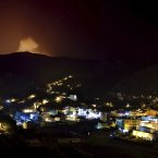 In this Sunday, Aug.12, 2012 photo, a wildfire advances on the residential area, in the evacuated Village of Valle Hermoso in La Gomera, Spain.  (AP Photo/Andres Gutierrez)