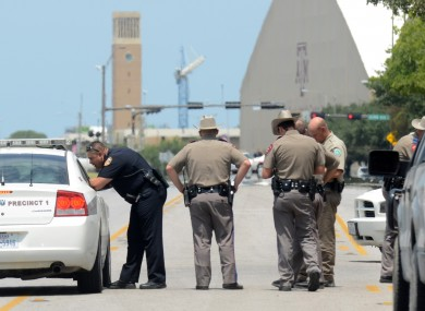 Texas State troopers and Brazos Valley lawmen work the scene of the shooting of two fellow law officers,