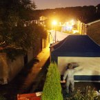 A police tent erected outside the home of Christine Sharp on Friday.
