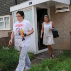 Christine Sharp, grandmother of missing school girl Tia Sharp, leaves her home escorted by police officers in New Addington near Croydon, Friday August 10 2012. Photo: Stefan Rousseau/PA Wire
