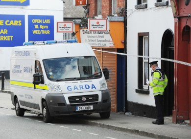 A team from the Garda technical bureau outside the house of Christopher Jackson on Prussia Street last weekend.
