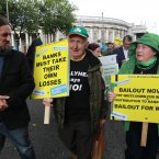 18/09/2012. Ballyhea / Charleville Protest. Today the people of Ballyhea and Charleville held a protest march to Leinster House, to demonstrate their frustration against the amount of money put into the banks in Ireland. Pictured (LtoR) Independent TD Luke Ming Flanagan talks with Pat and Francis O Brien from Ballyhea Co. Cork while marching to Leinster House today. Photo: Sam Boal/Photocall Ireland