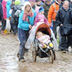 People try to make their way through the mud. Photo: Laura Hutton/Photocall Ireland