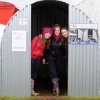 Katie Fitzpatrick, Zoe Whelan and Shona Walsh from Portlaoise keep dry in a rain shelter at the National Ploughing Championships. Photo: Laura Hutton/Photocall Ireland