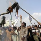 Afghans burn an effigy of US President Barack Obama during a protest in Khost, south-east of Kabul, Afghanistan today. A few hundred university students protested against an anti-Islam film which depicts the Prophet Muhammad as a fraud, a womanizer and a madman. (AP Photo/Nashanuddin Khan)