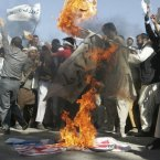 Afghans burn the U.S. flag in Herat, west of Kabul, Afghanistan, Sunday, September 16, during a protest against an Internet video mocking the Prophet Muhammad that many fear could further aggravate Afghan-US relations. 