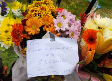 Floral tributes are left at the scene where a boy was fatally stabbed, on the Loughborough Road Estate, in Brixton, south London.