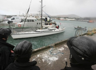 Armed naval officers guard the 'Dances with Waves' yacht which was seized off the west coast five years ago.
