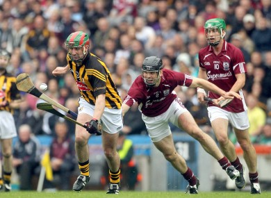 Eoin Larkin and David Collins battling in the Leinster final.