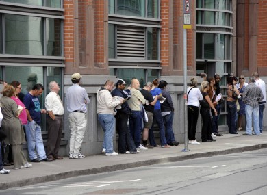 Members of the public queue outside the Social Welfare office in Bishops Square in Dublin's inner city