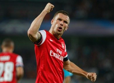 Arsenal's German forward Lukas Podolski, reacts after scoring against Montpellier.