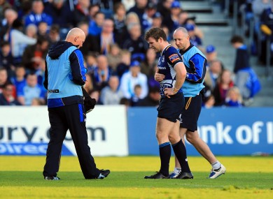 Gordon D'Arcy receives attention following a blow to the ribs.