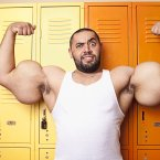Mostafa Ismail from Egypt has 'guns€™ (biceps and triceps) with a circumference of 64.77 cm (25.5 in): the largest in the world. He is featured in the new Guinness World Records 2013 book out today.