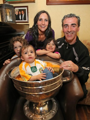 Manager Jim McGuinness with his family, wife Yvonne, and kids Toni-Marie, Michael Anthony and Jim Jr in the Sam Maguire Cup.
