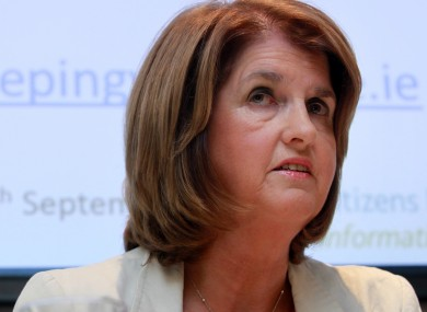 Joan Burton's department says it will not demand proof of payment of the Household Charge before issuing payments.