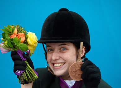 Kearney celebrates after winning a bronze medal in the dressage individual freestyle test - Grade Ia.